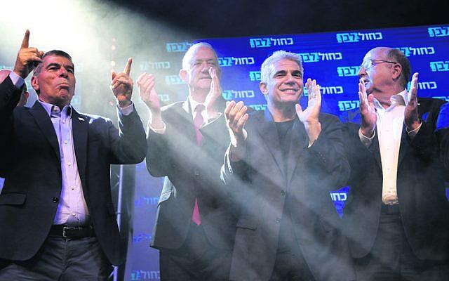 Blue and White's Gabi Ashkenazi, Benny Gantz, Yair Lapid and Moshe Ya'alon in celebratory mood as results come through. Photo: AP Photo/Sebastian Scheiner