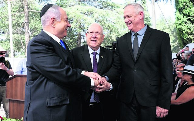 Benjamin Netanyahu, Reuven Rivlin and Benny Gantz attending a memorial service for Shimon Peres last Thursday. Photo: EPA/Abir Sultan