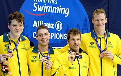 Australia's Matthew Levy (second from right) receiving his bronze medal with teammates. Photo: Swimming Australia