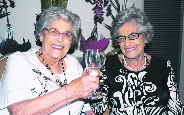 Stephanie Heller (right) and twin Annetta Able at their 90th birthday celebrations. Photo: Danny Gocs