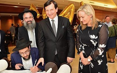 From left: Scribe Rabbi Shlomo Israel (seated) completing a Torah while Rabbi Slavin, Heffron MP Ron Hoenig and Coogee MP Dr Marjorie O'Neill look on. Photo: Henry Benjamin