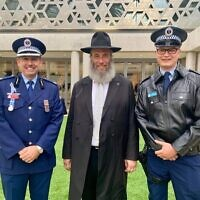 From left: Chief Inspector Matt Scott, Rabbi Mendel Kastel and Constable Peter Woodward.
