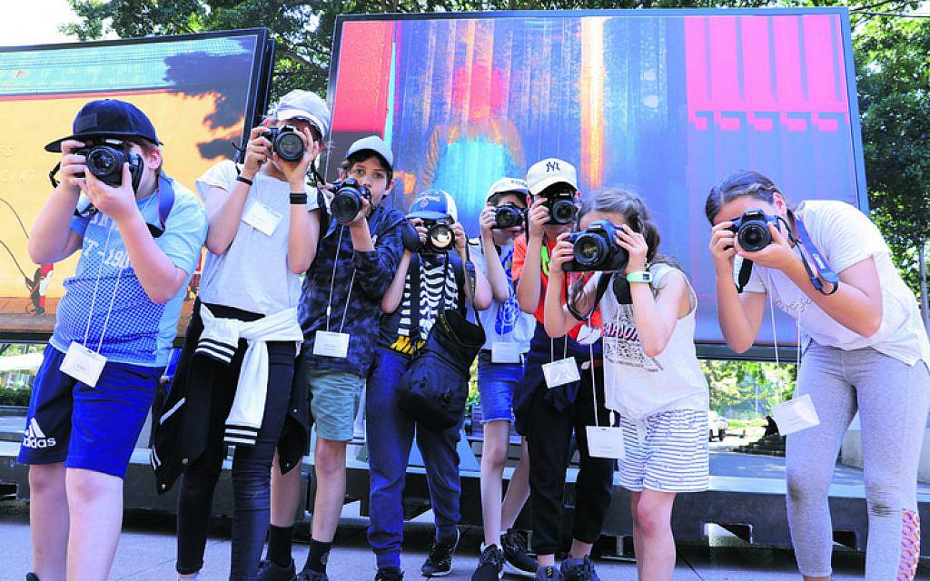 Workshop participants shooting in Hyde Park.