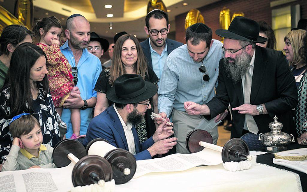 From left: Asher Lizor, Ella Lizor, Sharon Hendler, Talia Lizor, Nir Lizor, Orna Triguboff, Rabbi Shlomo Israel (seated), Daniel Hendler, Ariel Hendler, Rabbi Dr Dovid Slavin.