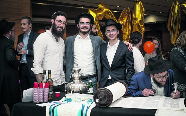 From left: Zevi, Mendel and Shlomie Slavin.