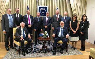 Israeli President Reuven Rivlin meets the Australian delegation, led by former prime minister John Howard. Photo: Mark Neiman, GPO