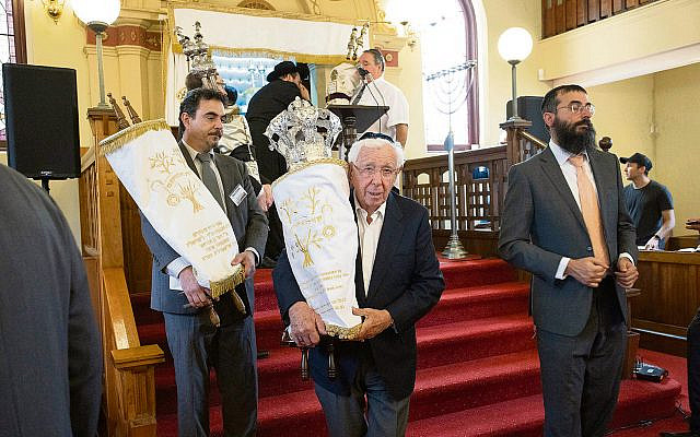 Frank Lowy carrying the Sefer Torah at the Siyum. Photos: Richard Weinstein