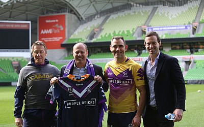 From left: Melbourne Storm head coach Craig Bellamy, Josh Frydenberg, Storm first grade captain Cameron Smith, and Storm CEO Dave Donaghy at AAMI Park, last Thursday. Photo: Melbourne Storm