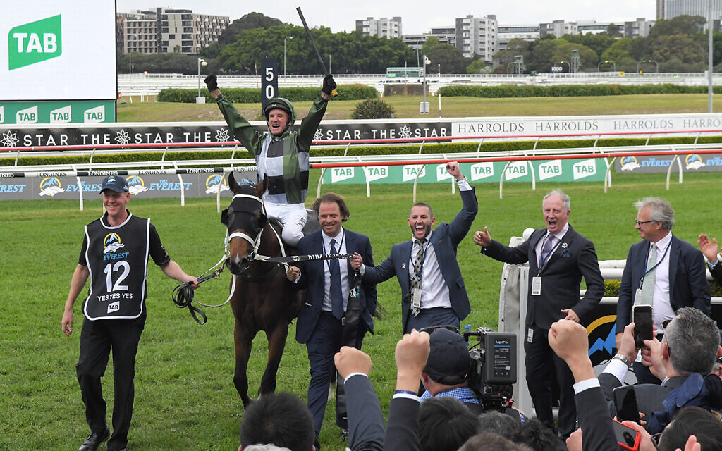 Brae Sokolski, third from right, leading Yes Yes Yes back after winning the $14 million TAB Everest at Royal Randwick on October 19, 2019. Photo: AAP Image/Simon Bullard