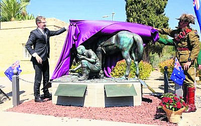 Australia's ambassador to Israel Chris Cannan (left) and Aboriginal Light Horseman Jack Pollard's grandson Mark Pollard unveil the statue.
