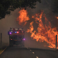 A fire truck at a bushfire near Coffs Harbour. Photo: AAP/Dan Peled