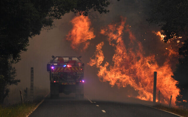 A fire truck at a bushfire near Coffs Harbour on Tuesday. Photo: AAP/Dan Peled
