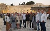 The mission participants visiting the Kotel.