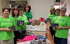 The eager volunteers of National Council of Jewish Women (Vic) get involved for Mitzvah Day last year.