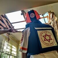 An MDA crew member at the site of the care home in Ashkelon hit by a rocket from Gaza. Photo: MDA