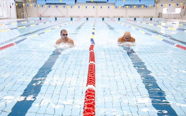 Andrew Maver (left) and Nathan Sable participating in the 2019 Maccabi MS National Swimathon at Melbourne's Bialik College pool. Photo: Peter Haskin
