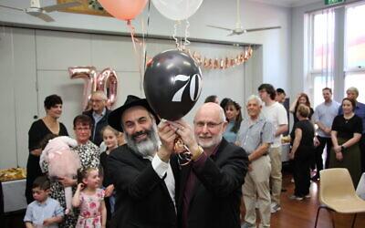 Rabbi Roni Cohavi (left) and Parramatta Synagogue president Michael Morris at the shule's 70th anniversary celebration.