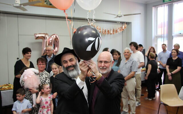 Rabbi Roni Cohavi (left) and Parramatta Synagogue president Michael Morris at the shule's 70th anniversary celebration.