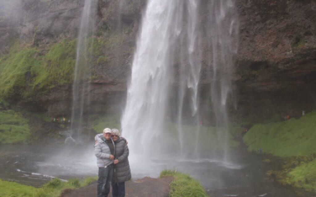 Raymond and Madeline Goodman at Greenland's Seljalandsfoss waterfall.