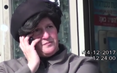 A private investigator tracked Malka Leifer as she spoke on the phone, while sitting on a bench in Bnei Brak, on December 14, 2017.