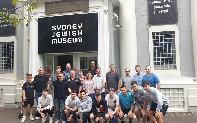 Mount Druitt Football Club players, parents and board members together with Hakoah Football Club board members outside the Sydney Jewish Museum.