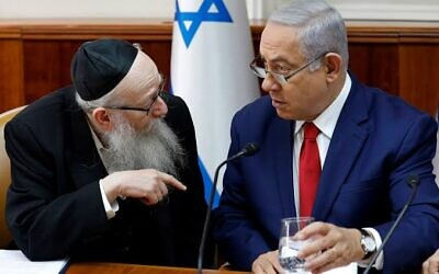 Benjamin Netanyahu, right, listens to Yaakov Litzman at the start of the the weekly cabinet meeting earlier this year in  the prime minister's office in Jerusalem.