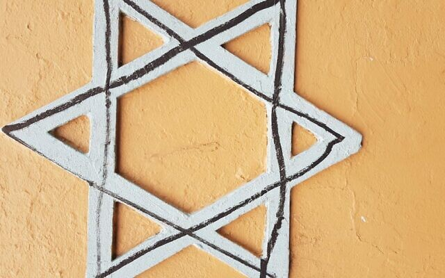 The Star of David defaced with a black marker.