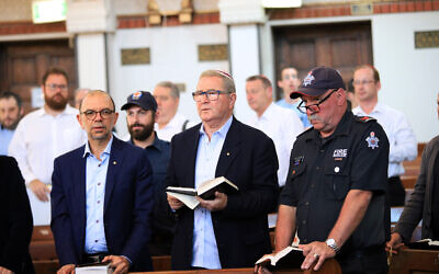 Rabbi Ralph Genende, David Smorgon and John Branagan from the Melbourne Metropolitan Fire Brigade at Sunday evening's service. Photo: Peter Haskin