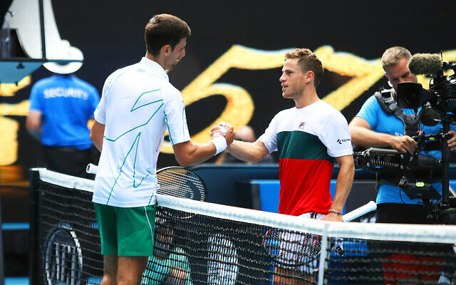 Novak Djokovic (left) shakes hands with Diego Schwartzman after the match. Photo: Peter Haskin