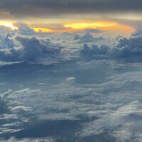 James Kennard entered this photo of sunrise above the clouds on a flight between Bangkok and Vienna.
