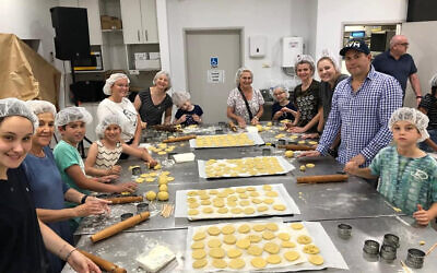 Baking cookies for firies and victims at Our Big Kitchen