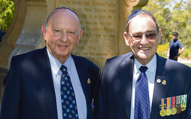 Keith Shilkin (left) with Warren Austin at the memorial.