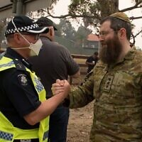 Rabbi Captain Dovid Gutnick and Victoria Police Senior Police Chaplain Drew Mellor in Mallacoota.