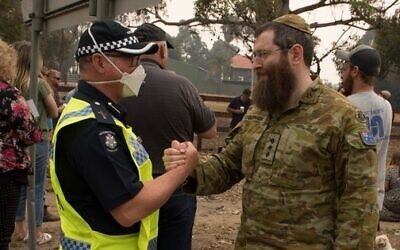 Rabbi Captain Dovid Gutnick and Victoria Police Senior Police Chaplain Drew Mellor in Mallacoota.