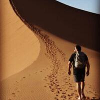 Daniel Samowitz climbing sand dunes in Namibia