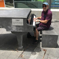 David Rothberg playing a concrete piano in Haifa.