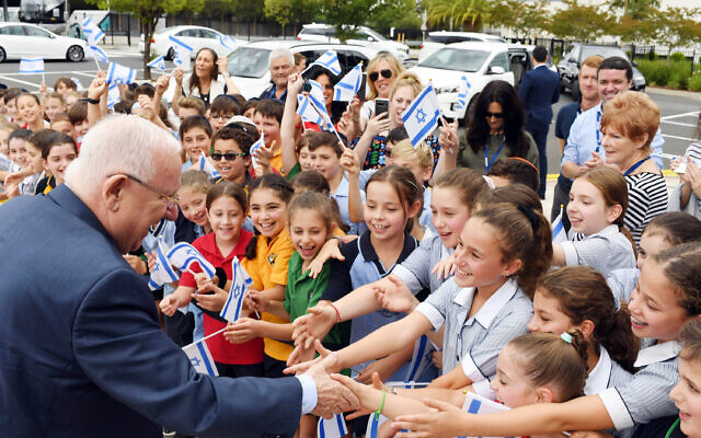 Reuven Rivlin is warmly welcomed by students of Mount Scopus Memorial College. Photo: Kobi Gideon/GPO
