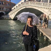 Ruth Trytell under the Rialto Bridge in Venice.