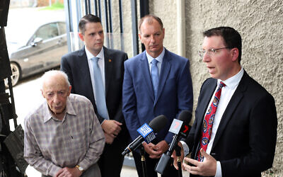 Anti-Defamation Commission chair Dvir Abramovich (right) speaking at a press conference earlier this month, flanked by (from left) Shoah survivor Joe de Haan, Brighton MP James Newbury and Caulfield MP David Southwick. Photo: Peter Haskin