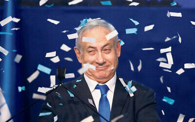 Israeli Prime Minister Benjamin Netanyahu in celebratory mood after the first exit poll results were released on Monday evening. Photo: AP Photo/Ariel Schalit