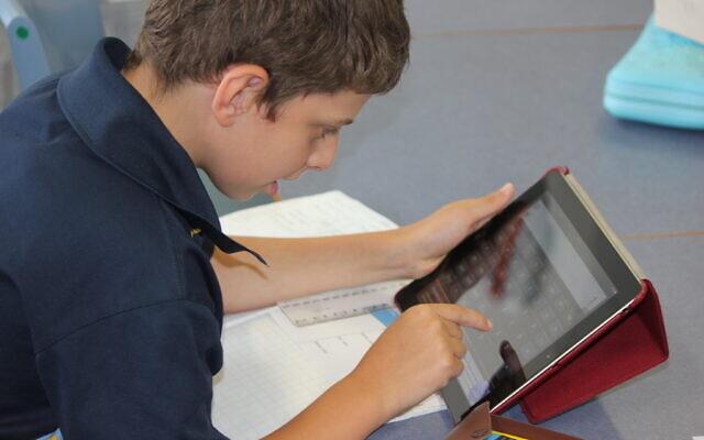 A Mount Sinai College student on their iPad.