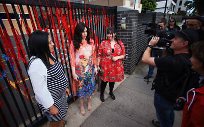 From left: Elly Sapper, Nicole Meyer and Dassi Erlich at the gate of Adass Israel School. Photo: Peter Haskin