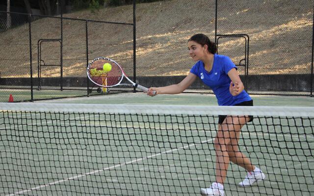 Lara Kaplan has begun a tennis scholarship at Binghamton University, USA. She is pictured training at Maccabi White City Tennis Club in Sydney last year. Photo: Shane Desiatnik