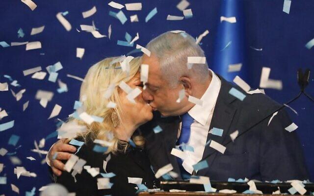 Benjamin Netanyahu kisses his wife Sara as exit polls predict a Likud victory. Photo: AP Photo/Ariel Schalit