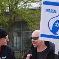A placard reading 'The real plague', depicting a Jew as a rat, brandished at an anti-lockdown protest in Ohio.  Photo: Twitter