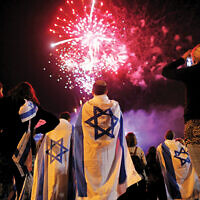 Yom Ha'atzmaut celebrations in Tel Aviv. Photo: EPA/Abir Sultan