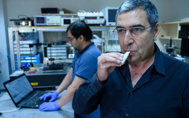 Professor Gabby Sarusi from Ben-Gurion University shows off the instant coronavirus breathalyser.