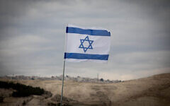 View of the Israeli flag and the area known as E1, in the West Bank, in January 2017. Photo: Yonatan Sindel/Flash90