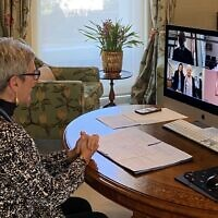 Victorian Governor Linda Dessau virtually invests Bella Hirshorn (bottom left corner of screen) with her AM in the state's first ever online investiture last week.