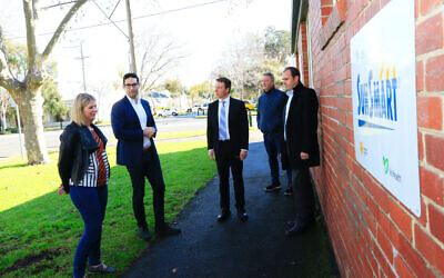 Josh Burns (second from left), Dvir Abramovich and Martin Foley with representatives from Middle Park Kindergarten on Tuesday. Photo: Peter Haskin